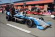 The car of Kyle O'Gara is wheeled down pit lane prior to qualifications -- Photo by: Chris Owens