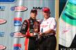 Sage Karam accepts his 3rd place trophy for the Lefty's Kids Club 100 at Auto Club Speedway -- Photo by: Chris Jones