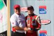 Gabby Chaves accepts his 2nd place trophy for the Lefty's Kids Club 100 at Auto Club Speedway -- Photo by: Chris Jones