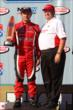 Carlos Munoz collects his winners trophy for the Lefty's Kids Club 100 at Auto Club Speedway -- Photo by: Chris Jones