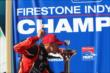 Sage Karam kisses the Firestone Firecup for winning the 2013 Firestone Indy Lights championship -- Photo by: Chris Jones