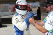 Boxer Victor Ortiz preps for his two-seater ride at Auto Club Speedway -- Photo by: Chris Jones