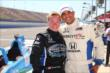 Sarah Fisher and boxer Victor Ortiz after their two-seater ride at Auto Club Speedway -- Photo by: Chris Jones