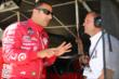 Tony Kanaan chats with Barry Wanser in his pit stand prior to the Open Test at Auto Club Speedway -- Photo by: Chris Jones