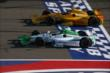 Teammates Carlos Munoz and Ryan Hunter-Reay go side-by-side at the stripe during the Open Test at Auto Club Speedway -- Photo by: Chris Jones