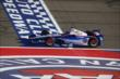 Helio Castroneves crosses the start/finish line during the Open Test at Auto Club Speedway -- Photo by: Chris Jones