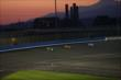 The sun sets over Auto Club Speedway during track activity at the Open Test at Auto Club Speedway -- Photo by: Chris Jones