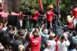 Helio Castroneves, Will Power, and Simon Pagenaud in a bicycle blender competition on stage at The Grove LA -- Photo by: Chris Jones