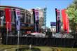 Driver flags fly on stage at The Grove LA during the meet-and-greet and media availability -- Photo by: Chris Jones