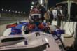 Mikhail Aleshin slides into his machine prior to the evening Open Test session at Auto Club Speedway -- Photo by: Joe Skibinski