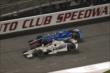 Simon Pagenaud and Ryan Briscoe go wheel-to-wheel during the Open Test at Auto Club Speedway -- Photo by: Joe Skibinski