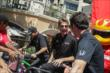 Will Power and Simon Pagenaud chat while Helio Castroneves continues to pedal his stationary bike at the meet-and-greet at The Grove LA -- Photo by: Joe Skibinski