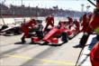 Scott Dixon finishes up a pit stop as Will Power roars by during Race 2 of the Shell and Pennzoil Grand Prix of Houston -- Photo by: Bret Kelley