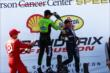 James Hinchcliffe and Scott Dixon give winner Will Power a champagne bath after Race 2 of the Shell and Pennzoil Grand Prix of Houston -- Photo by: Bret Kelley