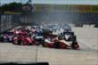 Helio Castroneves and Scott Dixon lead the field into Turn 2 at the start of Race 2 of the Shell and Pennzoil Grand Prix of Houston -- Photo by: Bret Kelley