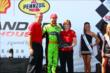 James Hinchcliffe accepts his 3rd place trophy for Race 2 of the Shell and Pennzoil Grand Prix of Houston -- Photo by: Bret Kelley