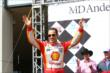 Helio Castroneves is introduced to the fans in Houston during pre-race seremonies -- Photo by: Chris Jones