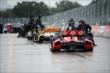 Cars roll back to the paddock -- Photo by: Chris Owens