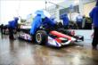 The A.J. Foyt Enterprises team cover up Takuma Sato's car before the qualification session -- Photo by: Chris Owens
