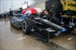 The Rahal Letterman Lanigan crew keep Graham Rahal covered up during the rain delay -- Photo by: Chris Owens