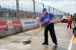 An A.J. Foyt Enterprises crewman sweeps up excess rainwater prior to cars being gridded for Race 2 of the Shell and Pennzoil Grand Prix of Houston -- Photo by: Chris Owens