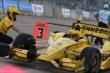Helio Castroneves enters his pit box. -- Photo by: Chris Jones