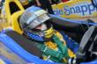 Marco Andretti waits in his car for practice. -- Photo by: Chris Owens