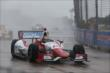 Justin Wilson navigates the turn in wet conditions. -- Photo by: Chris Jones