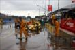 Crews work to clear water from pit road prior to the start of Race 1. -- Photo by: Chris Jones