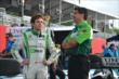 Carlos Munoz talks with a crew member before Qualifying. -- Photo by: Chris Owens