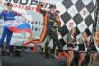 Simon Pagenaud celebrates on the podium. -- Photo by: Chris Owens