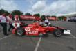 Scott Dixon's car heads back to the truck. -- Photo by: Chris Owens