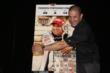 Tony Kanaan mimicking his likeness on the  2014 Indianapolis 500 ticket -- Photo by: Chris Jones