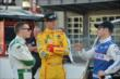 Competitors Mike Conway, Ryan Hunter-Reay and Ryan Briscoe talk in pit lane -- Photo by: Chris Owens