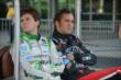 Andretti teammates Carlos Munoz and Franck Montagny relax in pit lane -- Photo by: Chris Owens