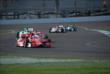 Scott Dixon leads a pack of cars through the IMS road course -- Photo by: Mike Young