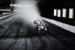 Ryan Briscoe leads a pack of IndyCar drivers into turn 1 -- Photo by: Bret Kelley