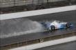 Tony Kanaan heading down the front straight in the rain -- Photo by: Chris Jones
