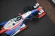 Ryan Briscoe crossing the yard of bricks -- Photo by: Walter Kuhn