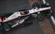 Will Power crosses the bricks -- Photo by: Walter Kuhn