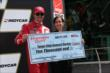 Scott Dixon receives a check for the Firestone Pit Stop Performance Award -- Photo by: Chris Jones