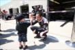 Helio Castroneves greets a young fan at IMS -- Photo by: Chris Jones