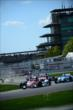 Helio Castroneves leads a group through the esses -- Photo by: Eric Anderson