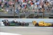 IndyCars head into turn 1 -- Photo by: Jim Haines