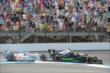 Indycars heading into Turn 1 -- Photo by: Jim Haines