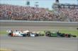 IndyCars in turn 1 -- Photo by: Jim Haines