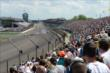 The field streams into Turn 1 during the Grand Prix of Indianapolis -- Photo by: Chris Owens