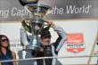 Simon Pagenaud hoists the Grand Prix of Indianapolis trophy -- Photo by: Chris Owens