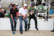 Sebastien Bourdais and James Davison speak with Al Unser Jr. -- Photo by: Chris Jones