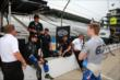 Josef Newgarden's team meets in pit lane -- Photo by: Chris Jones